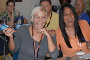 Spanish teacher Sara Collins and counselor Jennifer Bailey have a little fun while learning (Courtesy of SNN)