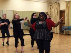 "The cast of the current production of ""Sister Act,"" rehearse. ""Sister Act"" runs through Feb. 26 - March 20."