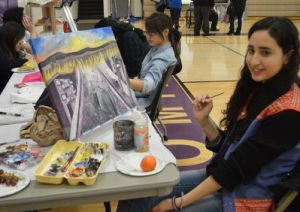 Kibsy works on a painting during the recent Wyoming High School Festival of Arts.