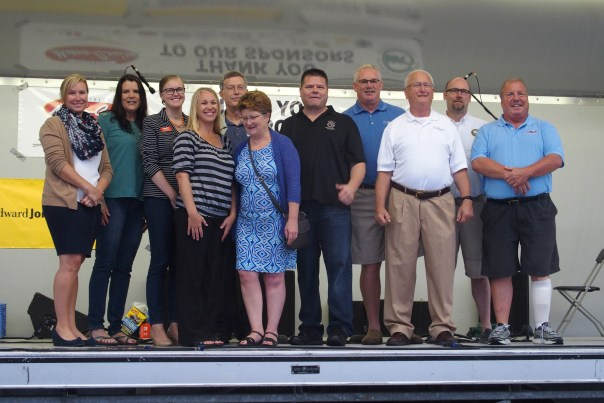 Members of the various organizations that received grant monies totaling $25,000 braved the rain to participate in this year's 28th Street Metro Cruise.