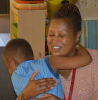 Kindergartner Ricky Brooks gives Christie Alexander an impromptu embrace