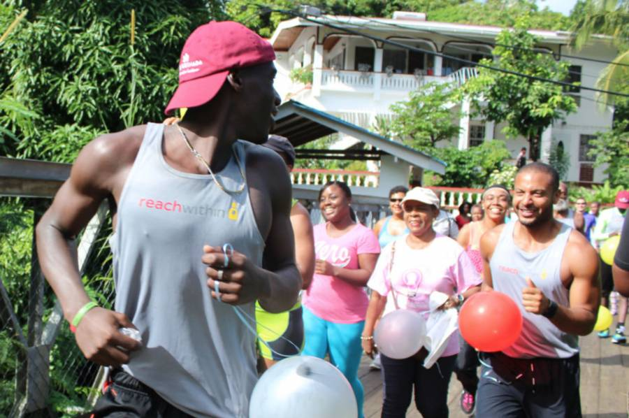The Last Mile Fun Run begins with Dennis Mason in front, Senator Brenda Hood (centre), and Brandon Jay McLaren (right) — #ARunForGrenada