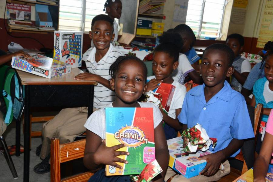 Students of Samaritan Presbyterian School unwrap new games