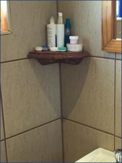 Berghaven bathroom corner shelf.