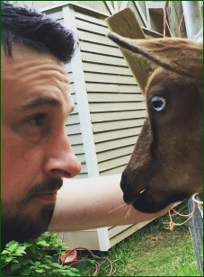 Tim Pepper face to face with goat.