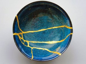 a Japanese bowl repaired with seams of gold