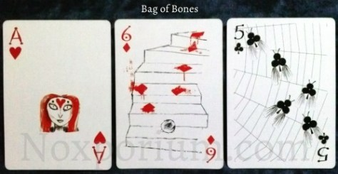 Bag of Bones: Ace of Hearts, 6 of Diamonds, & 5 of Clubs.