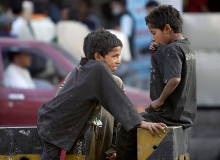 Street children sniff glue by the roadside in Kathmandu. Nearly one third of the population lives below the poverty line. According to UNICEF there are an estimated 30,000 street children in Nepal, of which 3,700 are homeless.