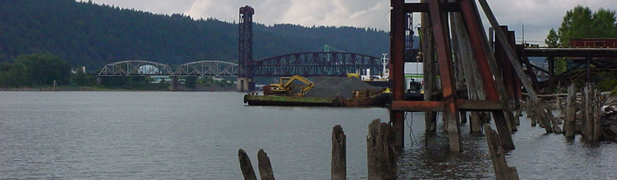 Railroad Bridge and barge being loaded
