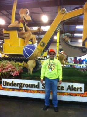 Marshall Johnson poses in front of the DigAlert float.