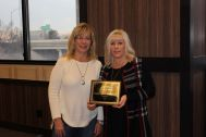 Julie Hearn presents plaque to Angela Emeterio – Frank Lepori Construction