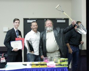 Billy Byrd, with Byrd Underground, accepts the Silver Shovel Award. His son, Tyler Byrd, stands to his left.
