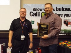 Robert Ward presented the Outstanding Performance Award to Jerrad Martin, JBM Underground.
