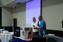 Robert Ward, left, and Craig Rogers, Public Utilities Commission of Nevada, choose a raffle winner.