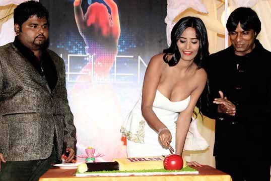 Poonam Pandey cuts world cup special cake& unveils Helen poster