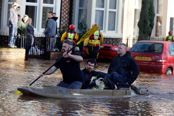 Severe flood warnings in parts of UK as Army helps; forecasts for more heavy rain