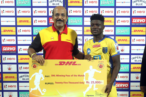 Mr. R.S. Subramanian, Country Manager, DHL Express India hands over the 'DHL Winning Pass' to Courage Pekuson from Kerala Blasters