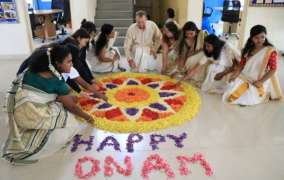 Canadian International School celebrates Onam with students & teachers from 40 different nationalities