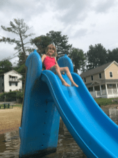Violet Savoie, 6, prepares to slide into the lake.