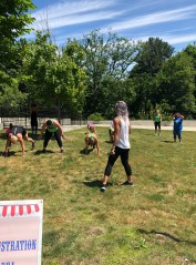 Tobin leads participants in a demonstration of Tobin Style Boot Camp at the 2018 Family Fair.