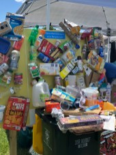 A display at the town's Refuse and Recycling booth shows items that can be recycled.
