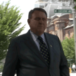 Teamster Boss James Hoffa about to enter White House gates.