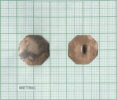 An 18th century octagonal button (front and back) recovered from an archaeological excavation. Items of clothing and personal adornment form a significant part of the collection and chart the evolution of trade patterns and style in Atlantic Canada over the centuries. Credit: Jonathan Fowler