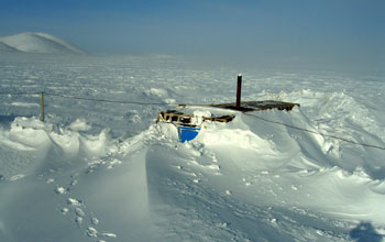 Photo of snow and ice covering a building at Lake E in the Russian Arctic.