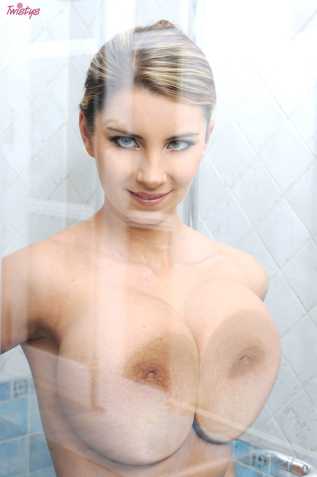 cross eyed blonde smashing her tits against the glass.jpg
