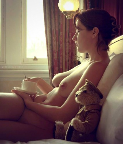 Nude girl and a bear can