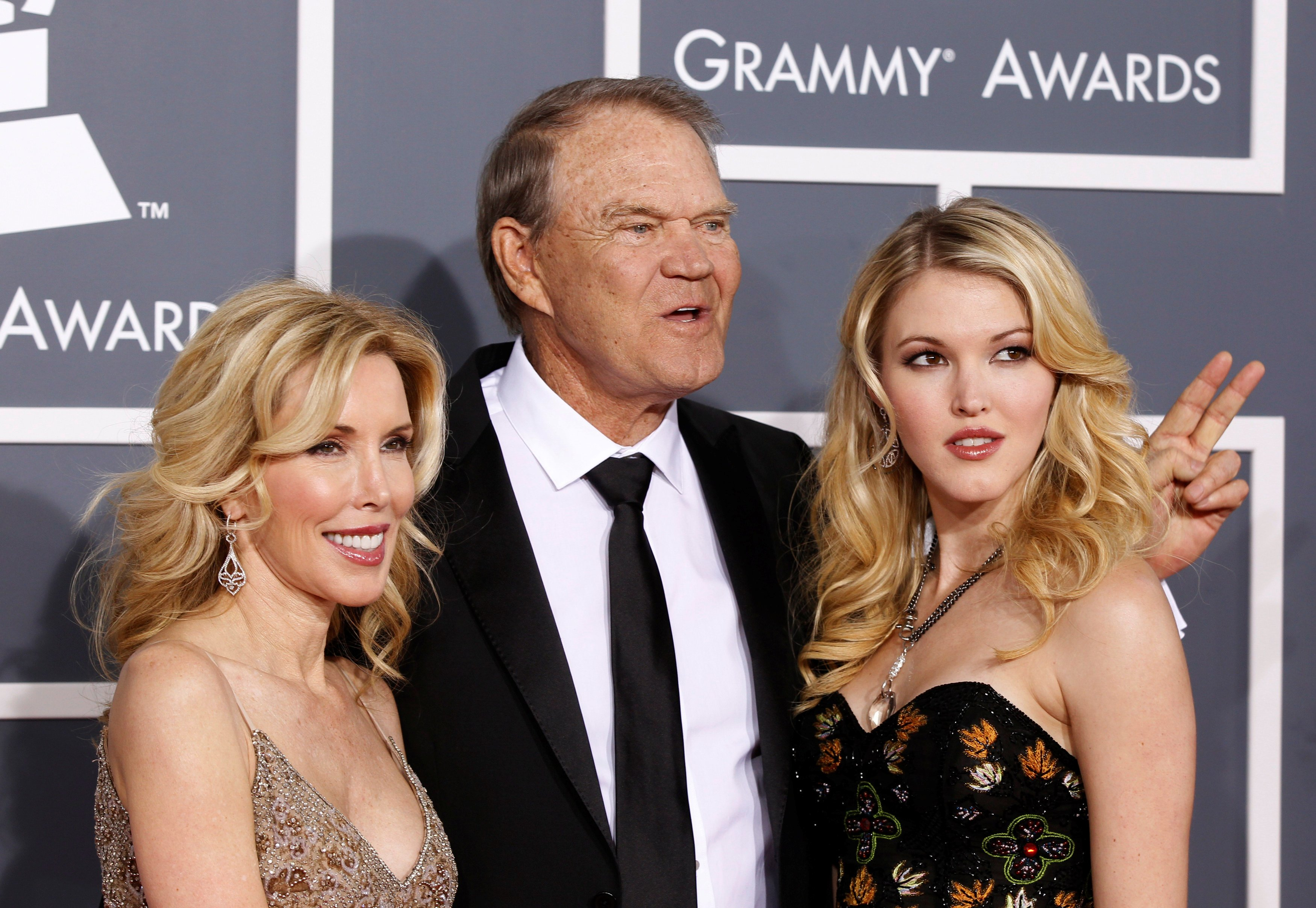 FILE PHOTO: Glen Campbell with his wife Kim (L) and daughter Ashley arrive at the 54th annual Grammy Awards in Los Angeles, California