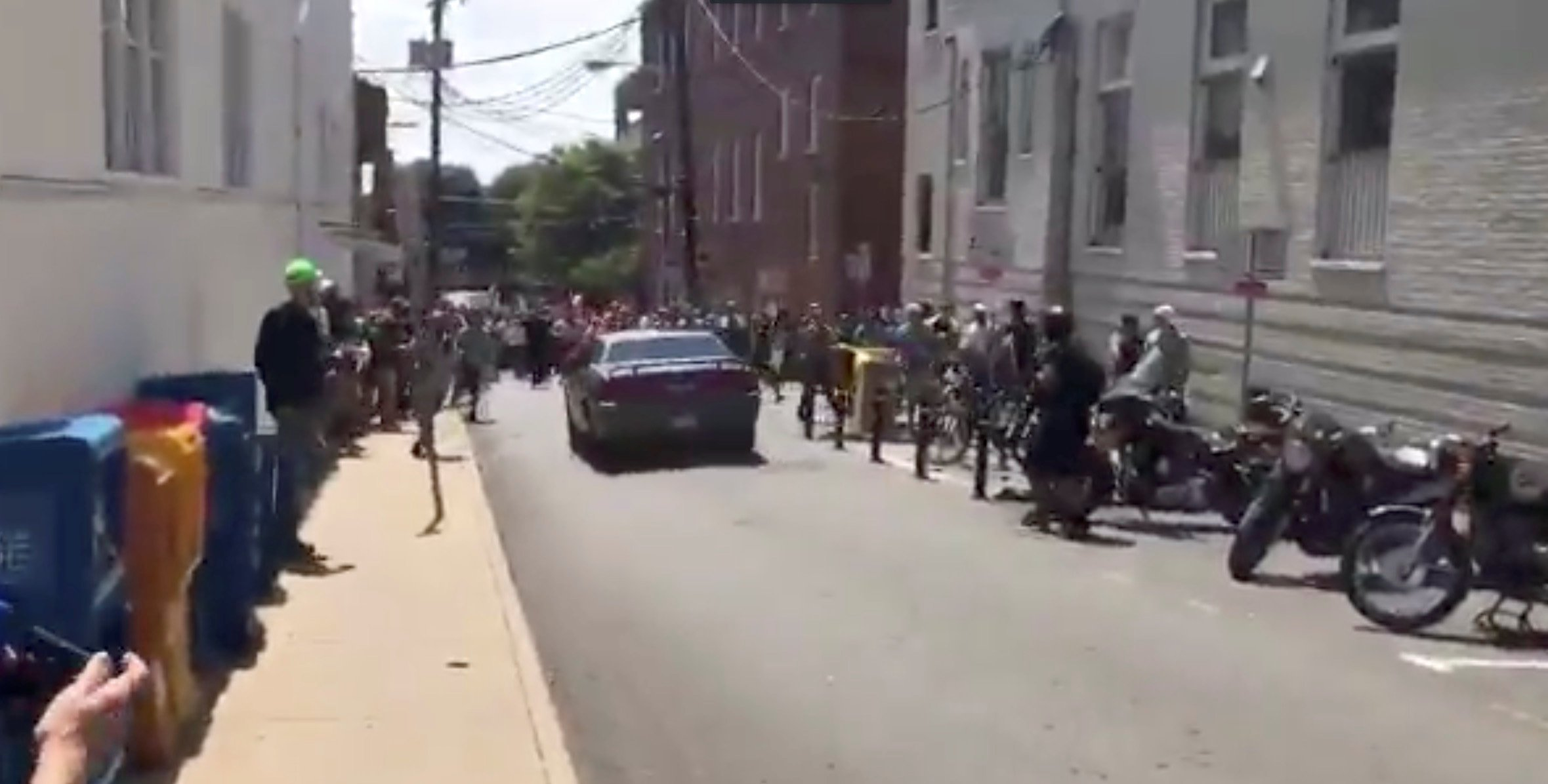 A vehicle is seen before plowing into the crowd gathered on a street in Charlottesville, Virginia, U.S., after police broke up a clash between white nationalists and counter-protesters, August 12, 2017, in this still image from a video obtained from social media. Courtesy of Brennan Gilmore