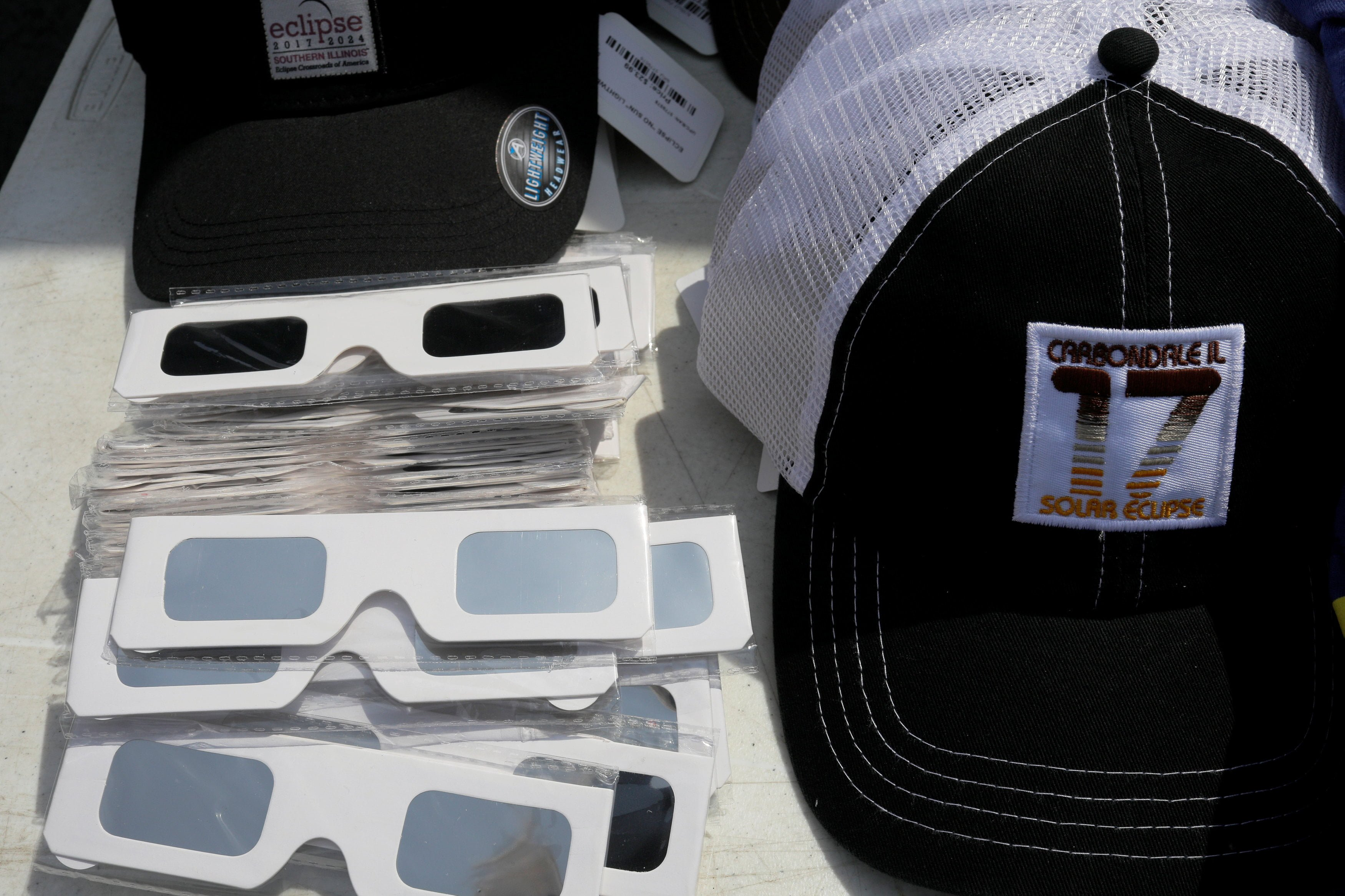 Solar viewing glasses and baseball caps are for sale in Carbondale, Illinois, U.S., August 20, 2017, one day before the total solar eclipse.