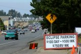 An Entrepreneurial sign for parking is displayed for drivers as they near the small town of Depoe Bay, Oregon as it prepares for the coming Solar Eclipse, August 20, 2017.