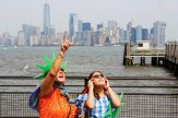 People view the solar eclipse at Liberty State Island as the Lower Manhattan and One World Trade center are seen in the background in New York, U.S., August 21, 2017. Location coordinates for this image are 40.4124° N, 74.237°. W