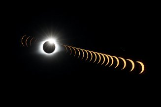 """A multiple exposure image shows the solar eclipse as it creates the effect of a diamond ring at totality as seen from Clingmans Dome, which at 6,643 feet (2,025m) is the highest point in the Great Smoky Mountains National Park, Tennessee, U.S. August 21, 2017. Location coordinates for this image are 35º33'24"""" N, 83º29'46"""" W. REUTERS/Jonathan Ernst"""