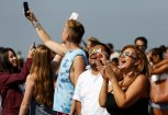 """People watch the solar eclipse on the lawn of Griffith Observatory in Los Angeles, California, U.S., August 21, 2017. Location coordinates for this image are 34°7'9""""N 118°18'1""""W. REUTERS/Mario Anzuoni"""