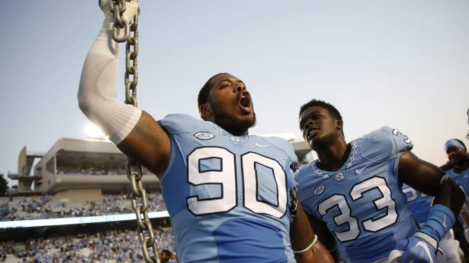df3df6c28fe North Carolina Tar Heels defensive tackle Nazair Jones (90) and North  Carolina Tar Heels defensive end Allen Cater (33) celebrate after the  college football ...