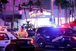 Las Vegas Metro Police officer stands by at a staging area in the intersection of Tropicana Avenue and Las Vegas Boulevard South after a mass shooting at a music festival on the Las Vegas Strip in Las Vegas, Nevada, U.S. early October 2, 2017. REUTERS/Las Vegas Sun/Steve Marcus