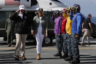 U.S. President Donald Trump arrives with first lady Melania Trump to meet with U.S. Virgin Islands Governor Kenneth Mapp, aboard the USS Kearsarge off the coast of San Juan, Puerto Rico, U.S. October 3, 2017. REUTERS/Jonathan Ernst
