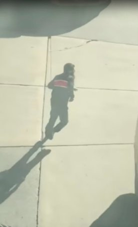 Suspected driver of the pickup truck that mowed down pedestrians and cyclists on a bike path alongside the Hudson River runs after the attack in the middle of a road, in New York City, NY, U.S., in this still image from a video obtained from social media October 31, 2017. TAWHID KABIR XISAN via REUTERS
