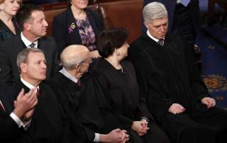 U.S. Supreme Court Chief Justice John Roberts and associate justices Stephen Breyer, Sonia Sotomayor and Neil Gorsuch sit together as they attend U.S. President Donald Trump's State of the Union address to a joint session of the U.S. Congress on Capitol Hill in Washington, U.S. January 30, 2018. REUTERS/Jonathan Ernst