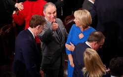 U.S. Environmental Protection Agency (EPA) administrator Scott Pruitt gives a thumbs up across the House chamber floor as he passes Education Secretary Betsy DeVos (R) after U.S. President Donald Trump delivered his State of the Union address to a joint session of the U.S. Congress on Capitol Hill in Washington, U.S. January 30, 2018. REUTERS/Jonathan Ernst