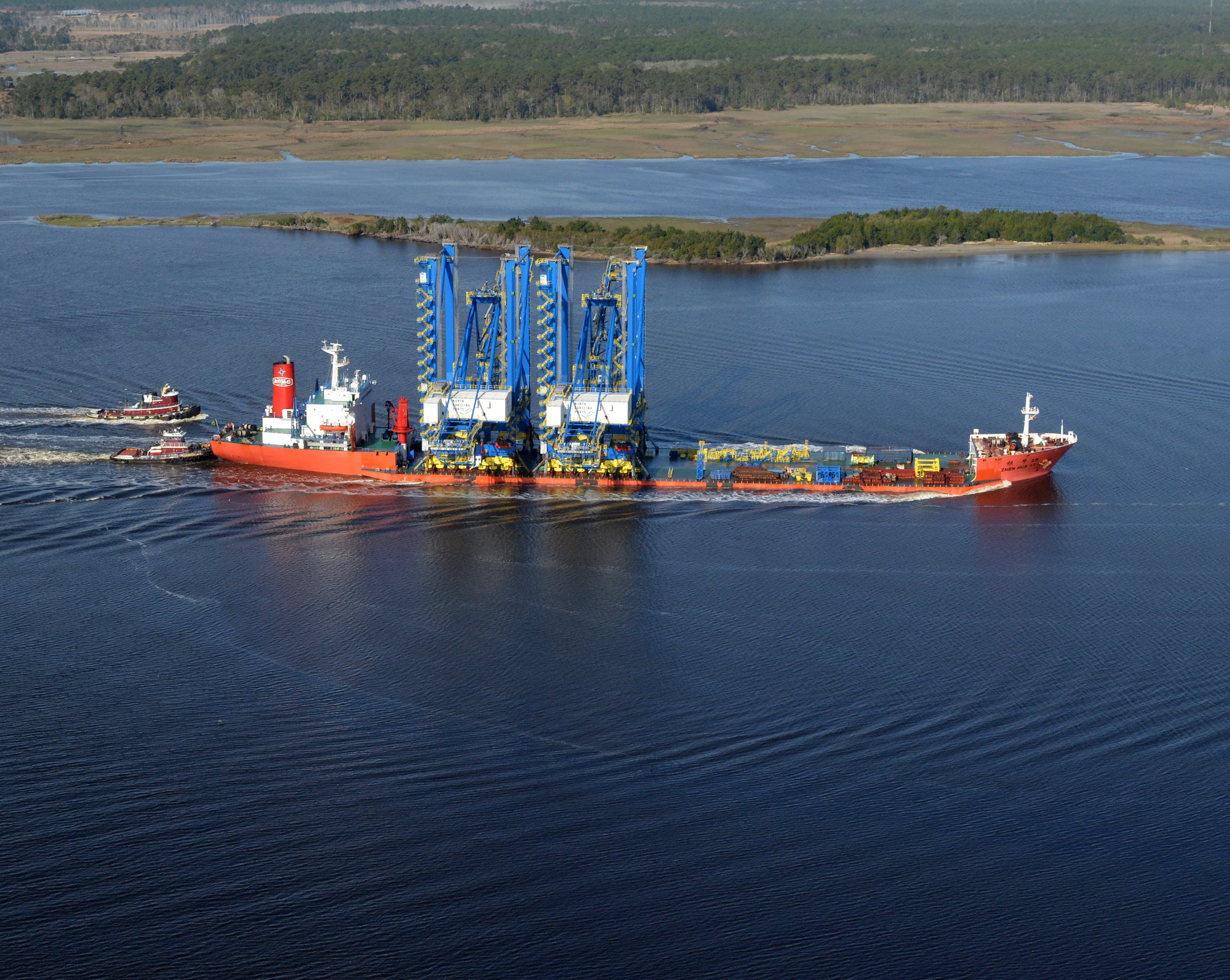 Two $33.5 Million Cranes Make Their Way Up The Cape Fear River Guided By  Boats From