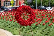 Poppies, the traditional symbol of remembrance, cover the lawn in front of the N.C. State Memorial Bell Tower for a ceremony honoring WWI veterans. May 1, 2018 in Raleigh. Shawn Krest, North State Journal.