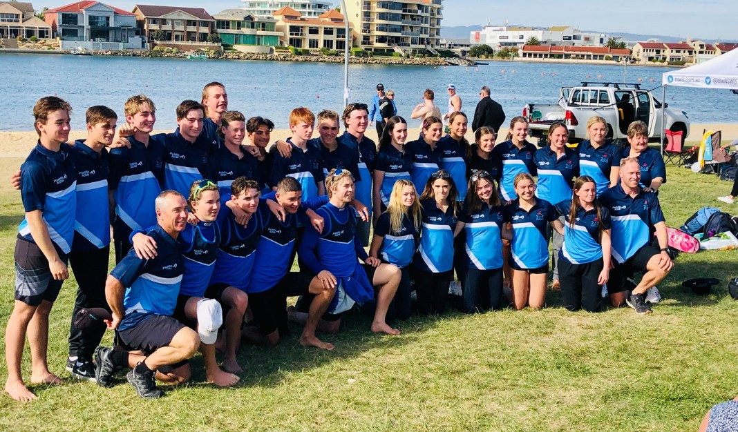 2021 NSW junior sprint team in blue t-shirts with race course in the background