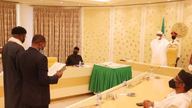 Photo of Buhari Swears in Two INEC Commissioners