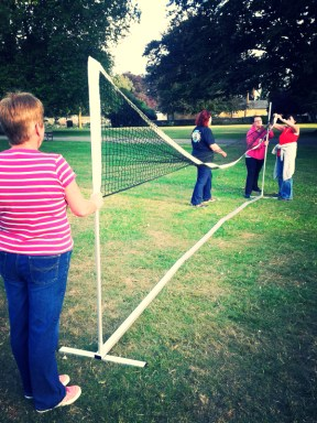 Putting up the badminton net - a group effort needed...