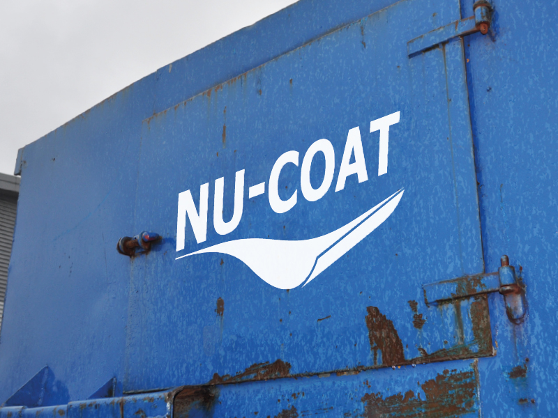 Nu-Coat logo CAD cut out in gloss white vinyl and applied to an outdoor blue rusty skip.