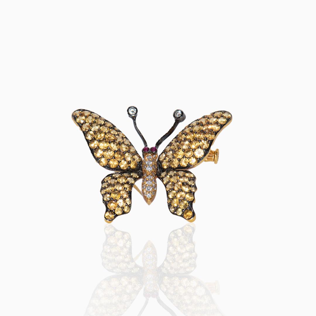Broche de Oro Zafiros Rubíes y Diamantes en Mariposa